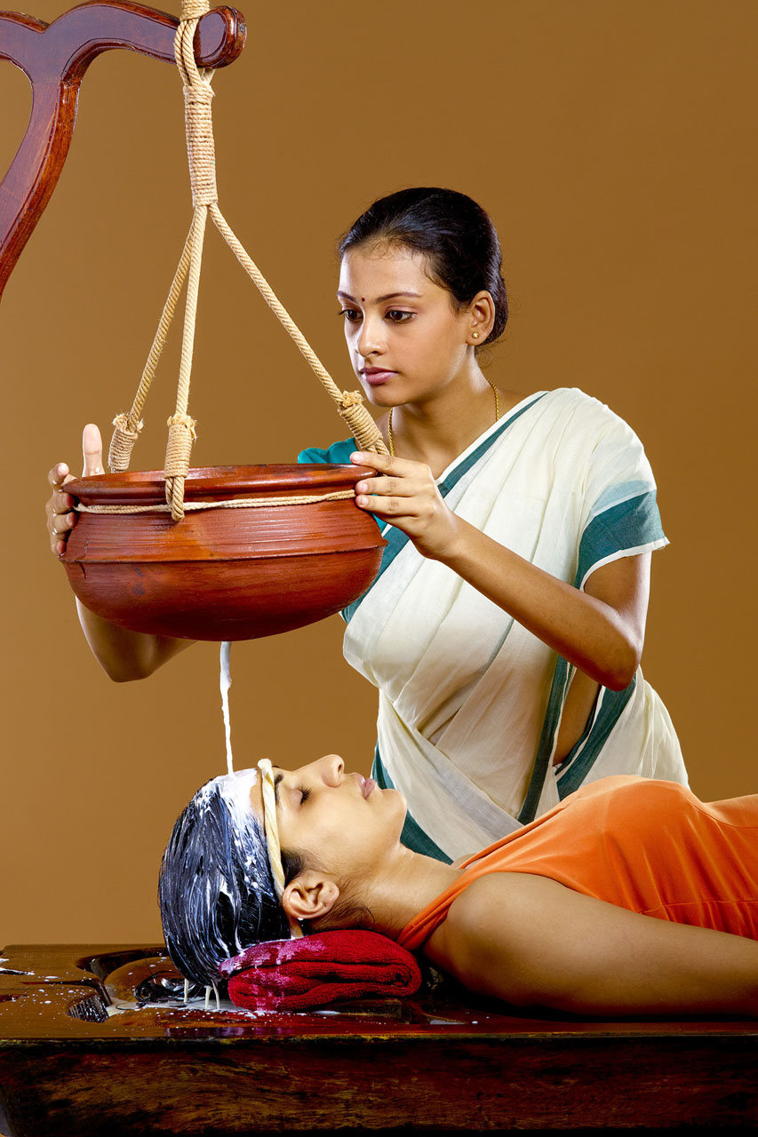 Ayurveda Shirodhara with milk Therapy Kerala